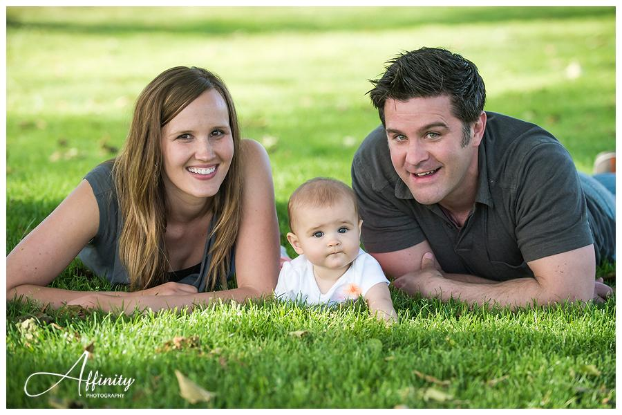 14-mom-dad-baby-daughter-laying-in-grass.jpg