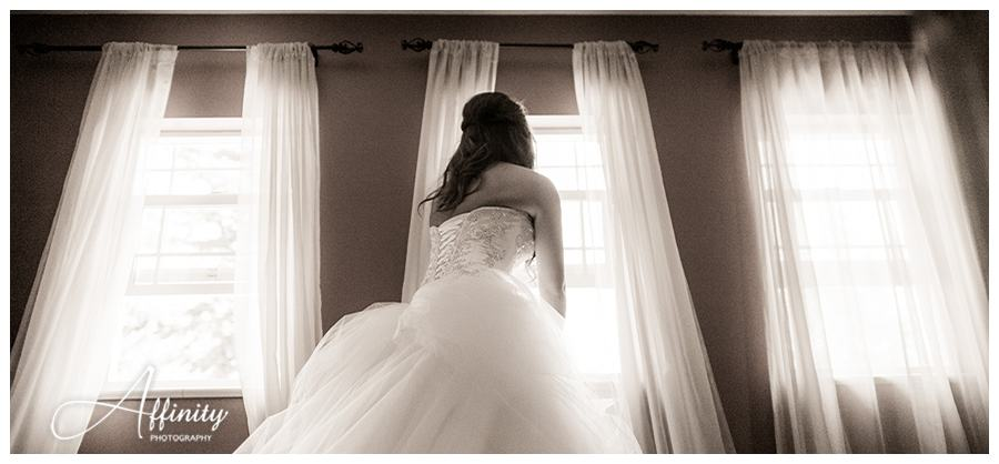 11-bride-peeks-groom-window.jpg