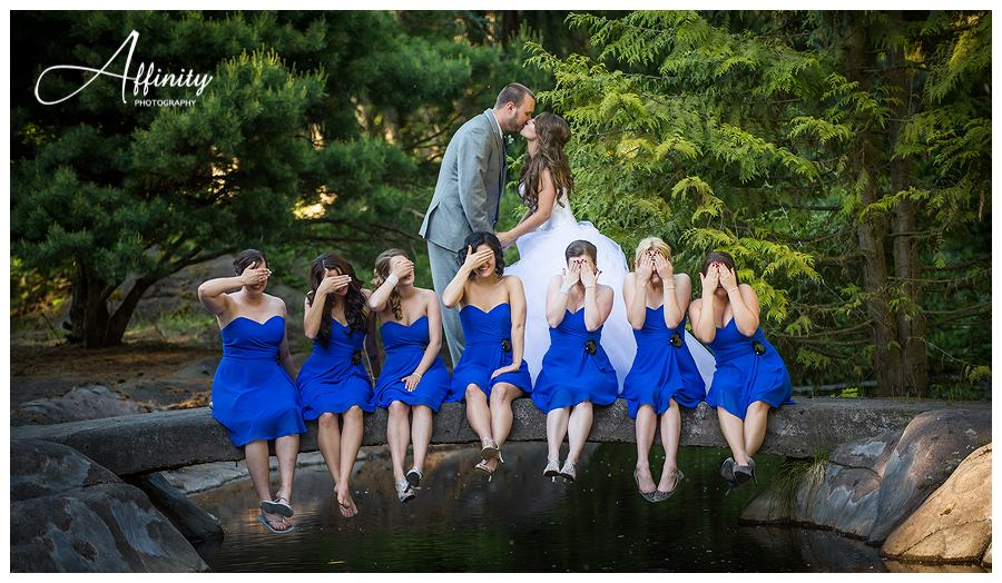 37-bridesmaids-cover-eyes-bride-groom-kissing.jpg
