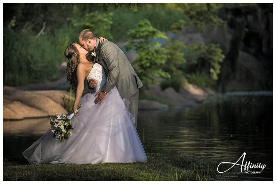 39-bride-groom-kiss-lake.jpg