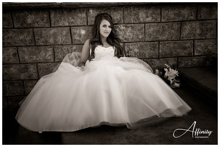 41-bride-dress-sitting-rock-wall.jpg