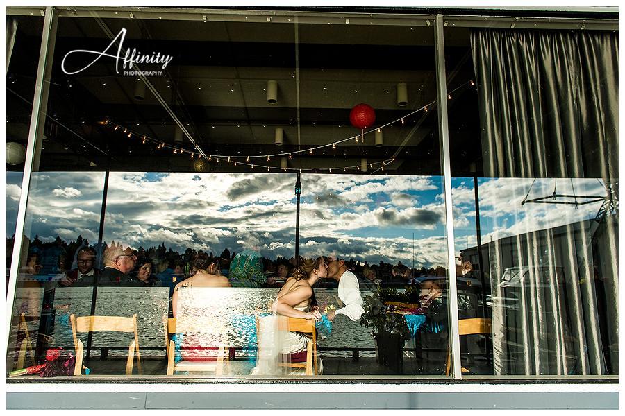 26-bride-groom-kiss-window.jpg