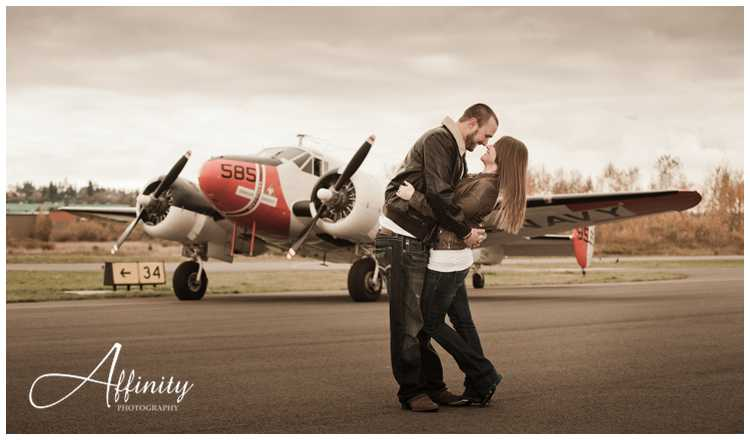 05-kissing-in-front-of-vintage-aircraft-runway.jpg