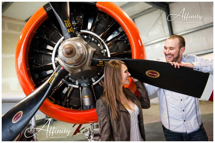 15-standing-propeller-engagement-session-airplane.jpg