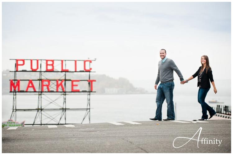 nick-kelsey-005-public-market-sign-engaged-couple-walking.jpg