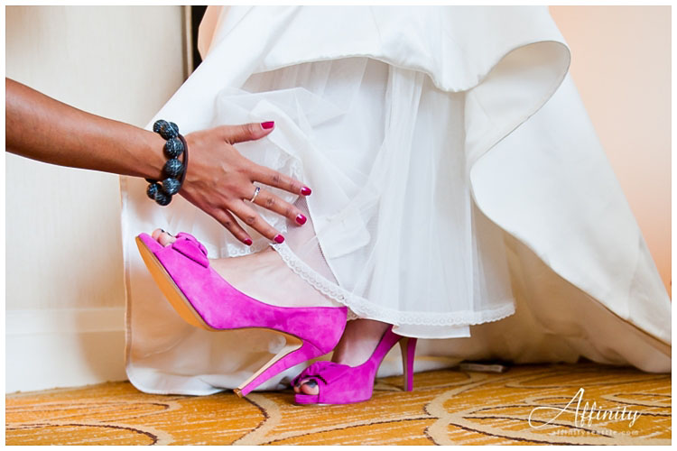 011-bride-puts-pink-shoes-on.jpg