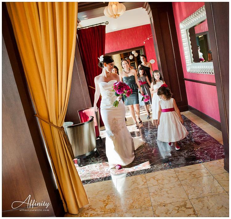 013-flower-girls-walking-with-bride-hallway.jpg