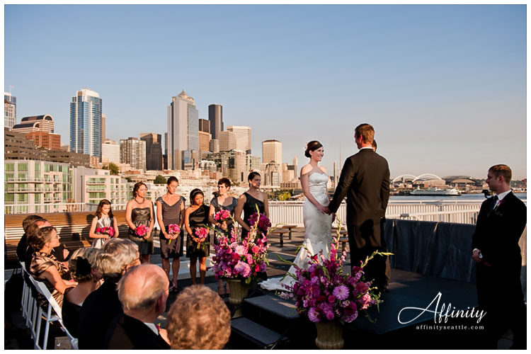 028-bride-groom-stand-ceremony-rooftop-city-seattle.jpg