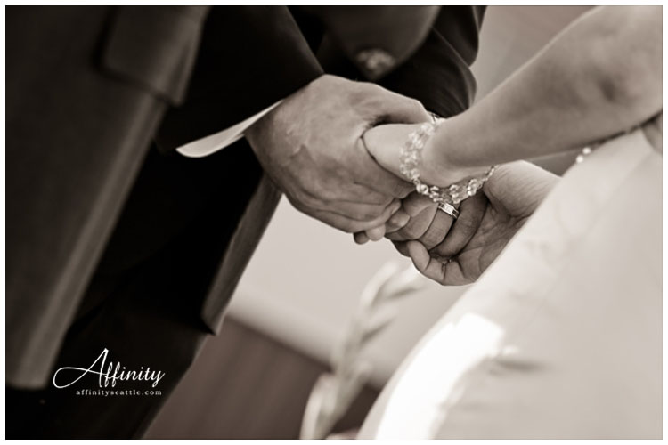 031-bride-groom-holding-hands-ceremony.jpg