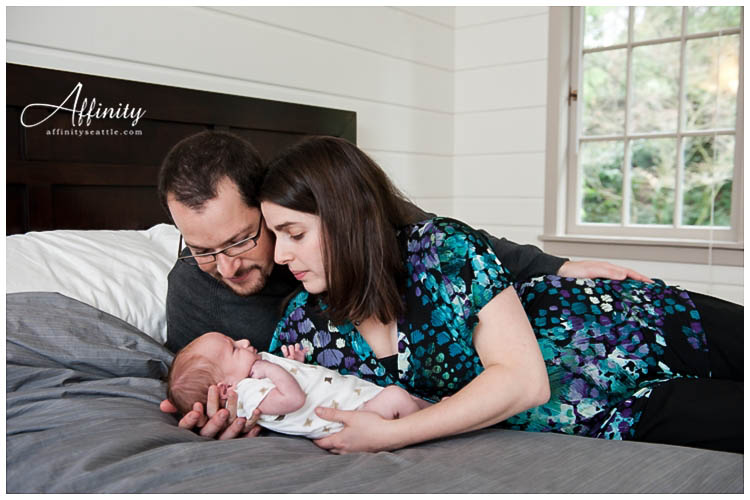 005-mother-father-laying-with-baby.jpg