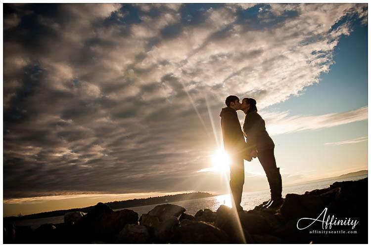 015-kiss-sun-clouds-rocks-silhouette.jpg