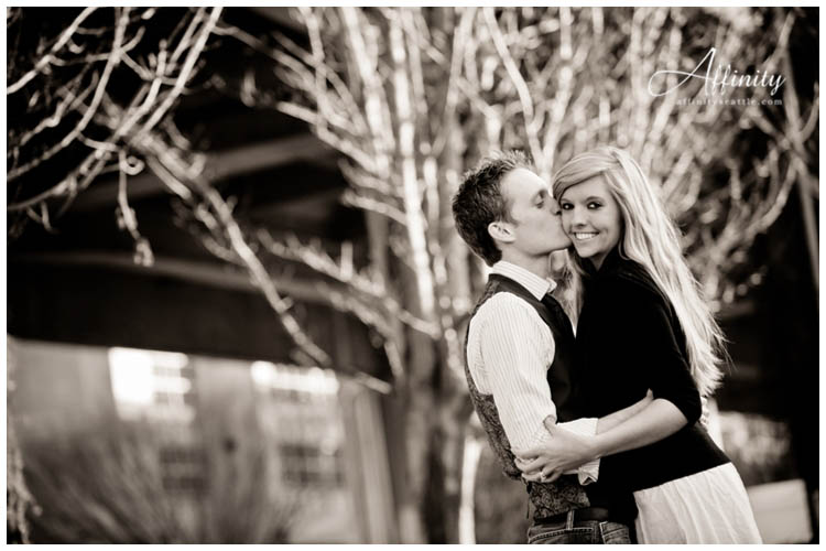 003-kissing-cheek-engagements-seattle-waterfront.jpg