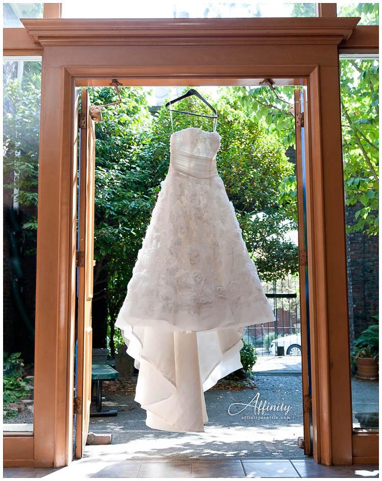 018-wedding-dress-hanging-in-doorway.jpg