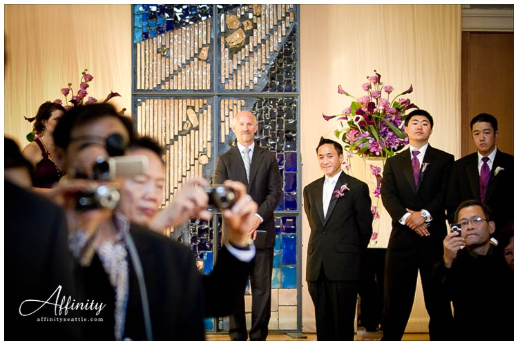 027-groom-watching-bride-walk-isle.jpg