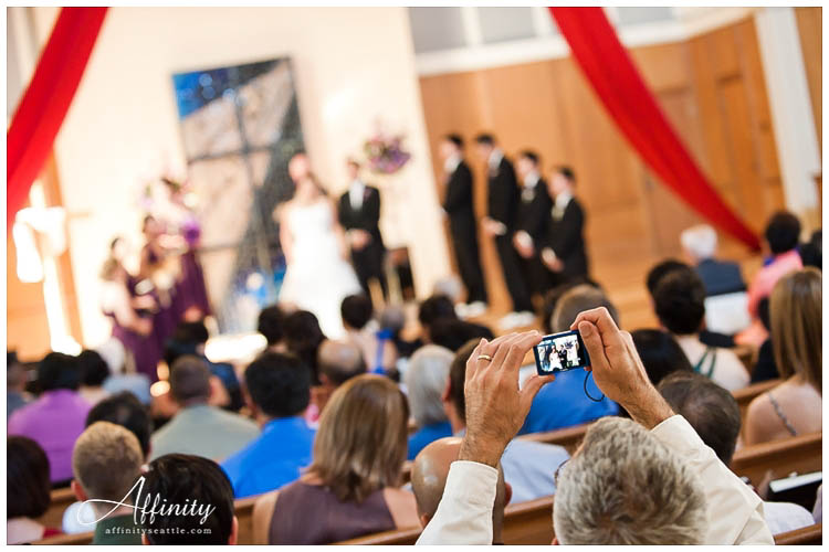 031-wedding-guests-takes-photo.jpg