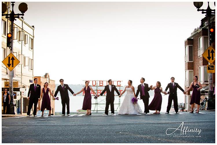 053-bridal-party-walking-across-street-pike-place-market.jpg