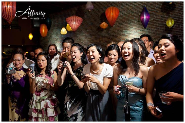 073-georgetown-ballroom-guests-cheer-wedding-cake.jpg