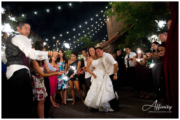 081-bride-groom-surrounded-by-sparklers.jpg