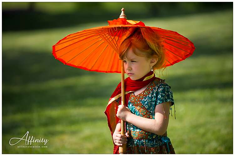 016-indian-ceremony-little-girl-holding-umbrella.jpg
