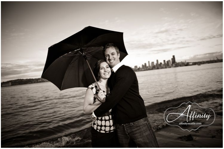16-engaged-couple-umbrella-seattle-beach-water-puget-sound.jpg