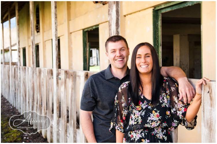 05-couple-smiling-fence-barn.jpg