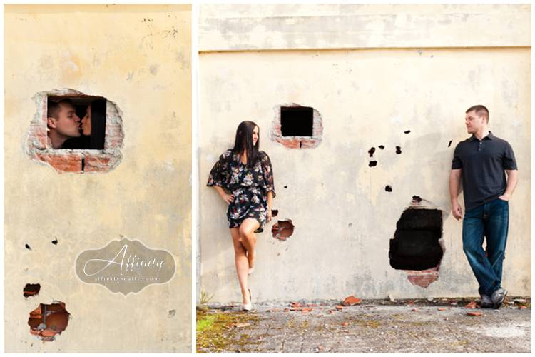 06-engagement-portraits-kissing-hole-wall.jpg