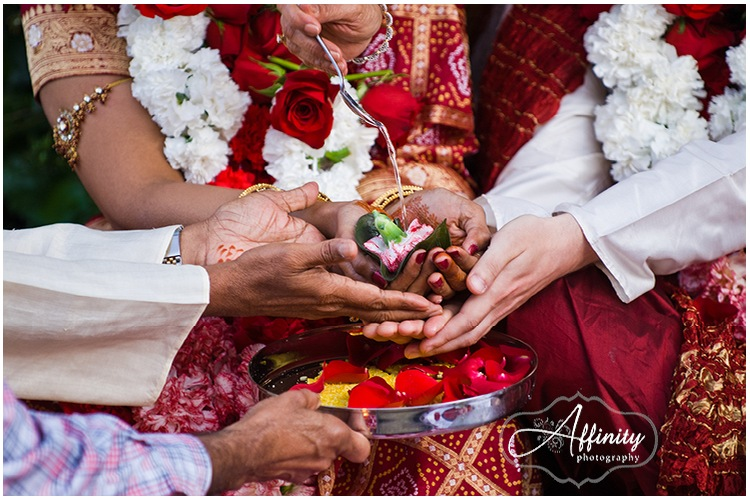 09-indian-wedding-ceremony-water-flower-drip-spoon.jpg