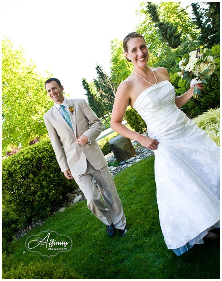 13-bride-groom-walking-grass.jpg