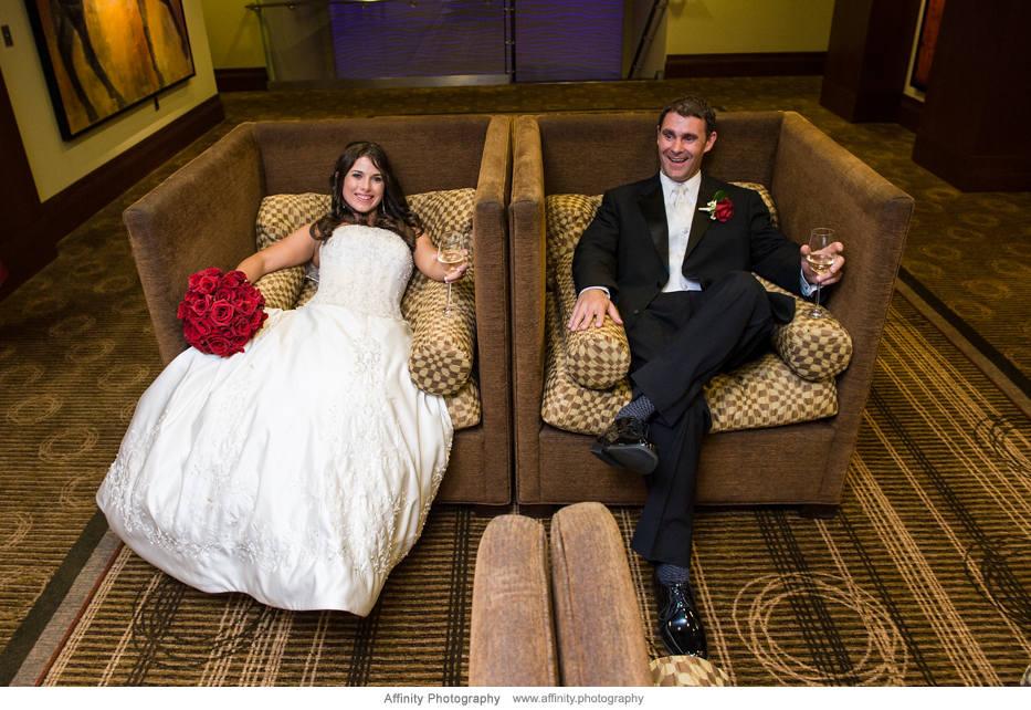 groom-bride-sitting-separate-chairs.jpg