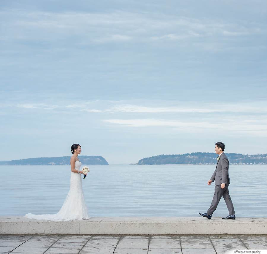 13-groom-walking-towards-bride-waterfront-beach-ocean.jpg