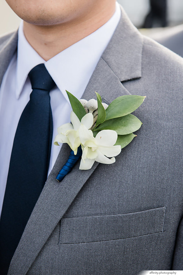 17-Boutineer-groom-flower-jacket.jpg
