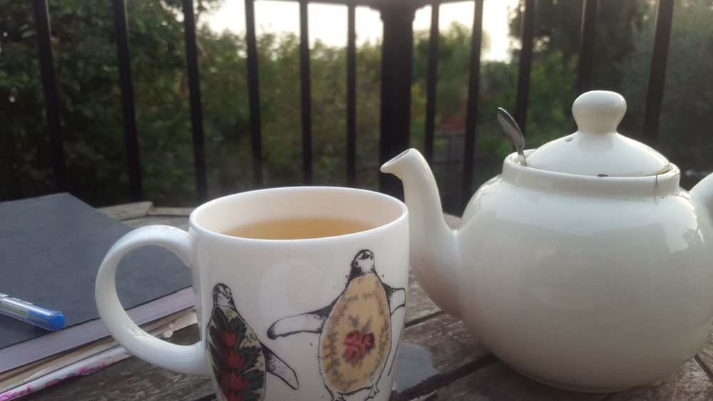Cathy enjoys a cup of tea outside while watching for birds. Image: Cathy Cavallo.