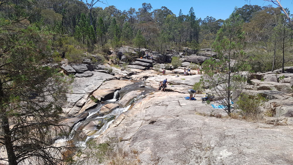 In summer, Woolshed Falls is a great place to enjoy the sun and cool down in the pools that surround the falls.  Image: Cathy Cavallo