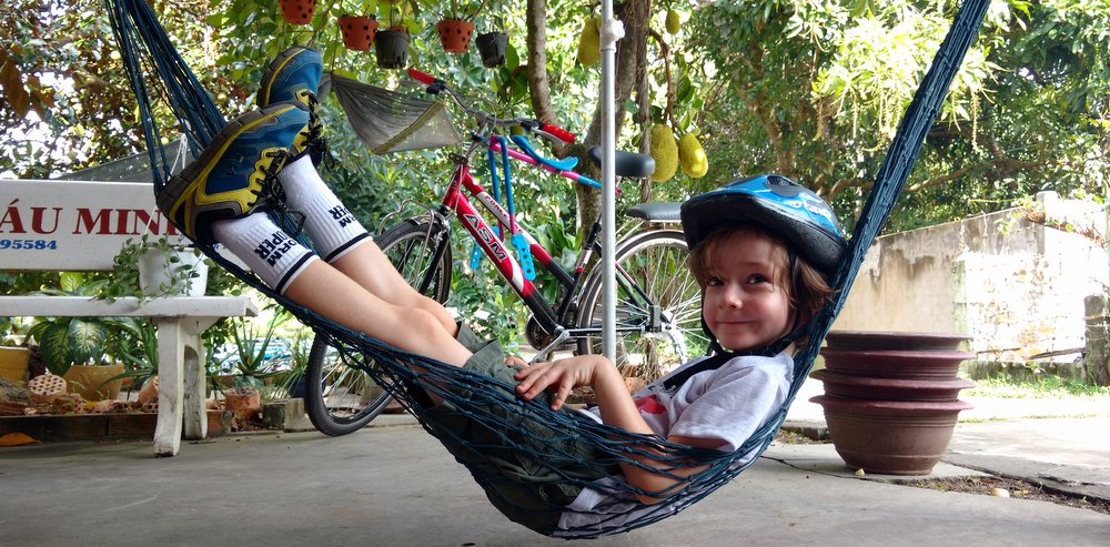 Mac, chilling in Cantho, Vietnam after a lovely stretch of Mac Riding through village lanes