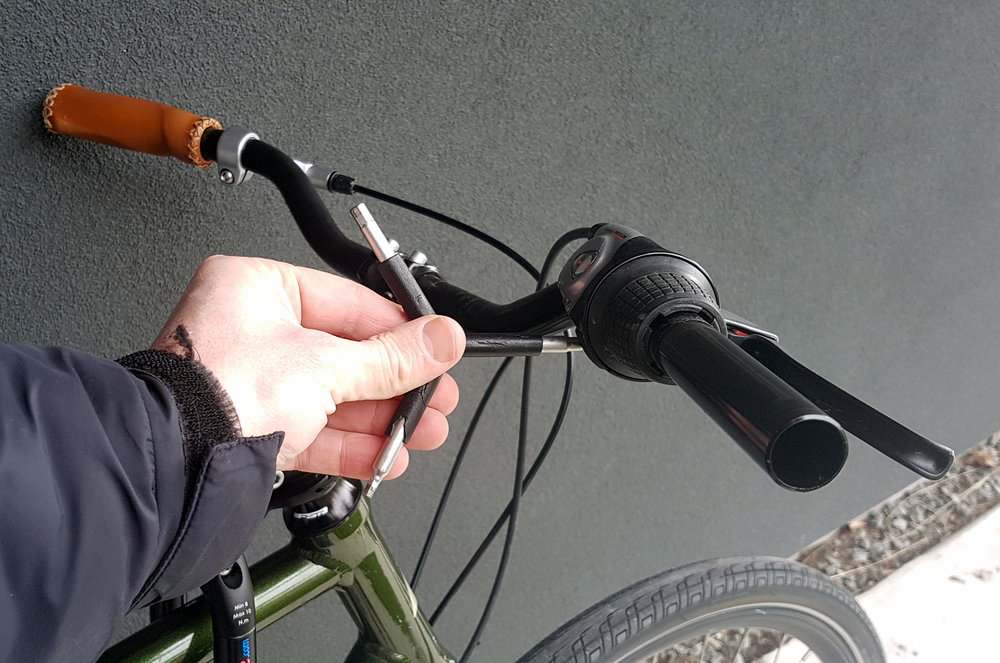 2. Remove adult grip, brakes/gears on 1 side