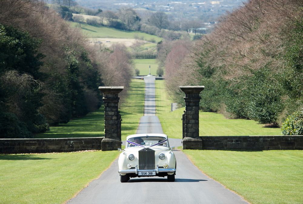 A wedding car approaches Hoghton Tower