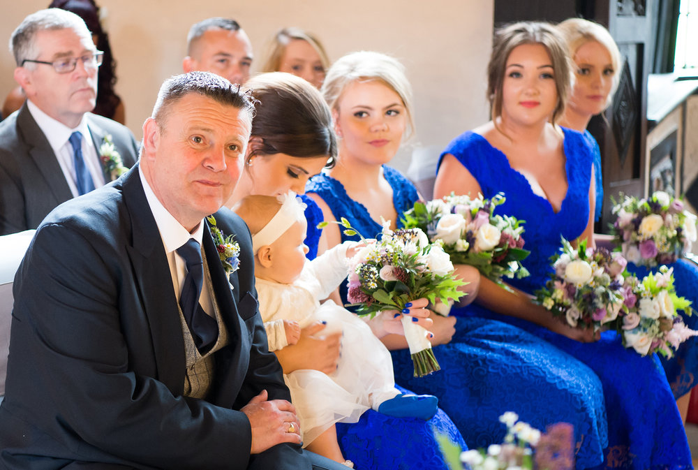 Father of the Bride and Bridesmaids photographed during the wedding ceremony