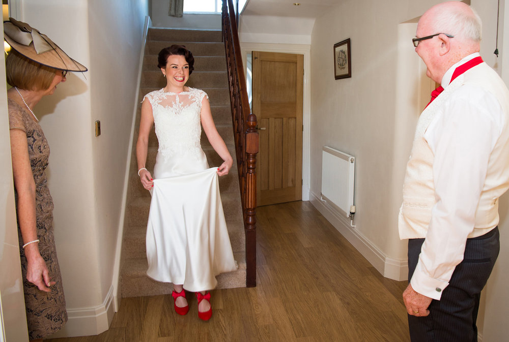 Bride reveals her wedding dress to her Dad