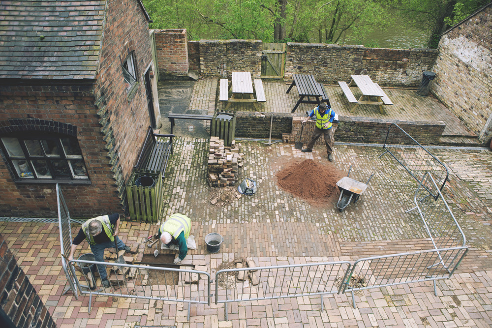 Maintenance workers restore the original brick path at the Coalport China Museum