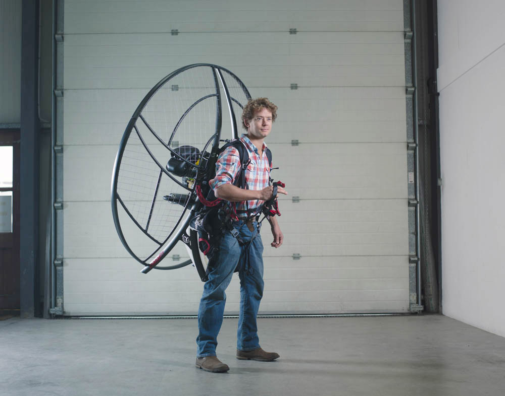 Gilo Cardozo, Founder of Parajet, wearing one of his powered para-glider motors.