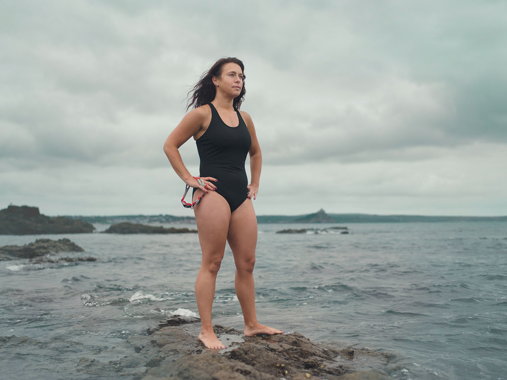 Maria Davey, preparing to swim off of Battery Rocks in Penzance, Cornwall.