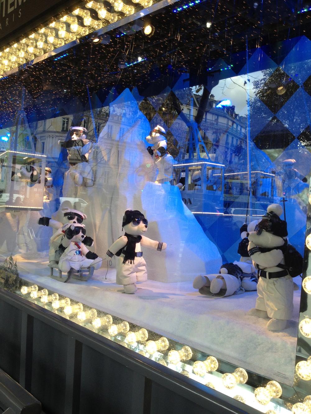 Printemps Prada snow window display with each mechanical teddy wearing a mini Prada backpack.