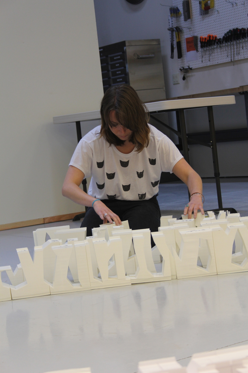 Stephanie Smith arranges pieces of the Smith|Allen sculpture underway printed using Type A Machines 3D printers.