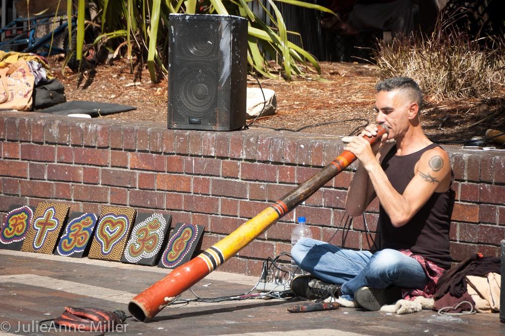 Man playing a didgeridoo