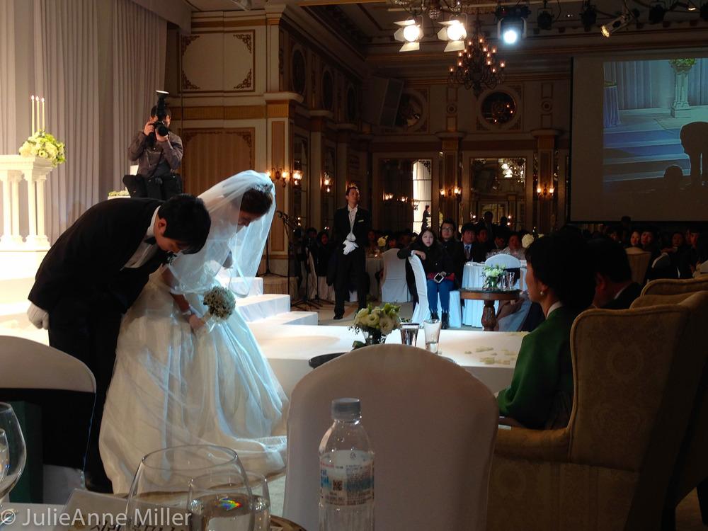 Korean couple bows to parents