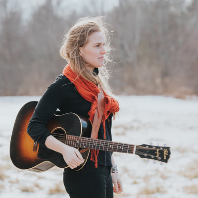 """With a captivating soprano voice and award winning songwriting, Caroline Cotter 's travel inspired songs take listeners all over the world and into the depths of the human heart. Since her debut album, """"Dreaming as I Do"""", released and reached #5 on the Folk DJ Charts in 2015, Caroline has performed over 450 shows in 42 states and 10 countries.Currently touring to support her second major release, """"Home on The River"""",  No Depression  calls it """" sweet and smooth, and downright refreshing... raising spirits with one song, calming them with another."""" Tom Wilk of   Icon Magazine  writes,"""" Her well-constructed songs bring to mind the early work of Mary Chapin Carpenter."""" """"  Today's folk scene has a new champion, one who encapsulates the sweetness, serenity and sophistication that has always made the genre so affecting in such a timeless manner. In that regard, 'Home on the River' is an absolutely essential record."""" (Lee Zimmerman/ Country Standard Time )"""