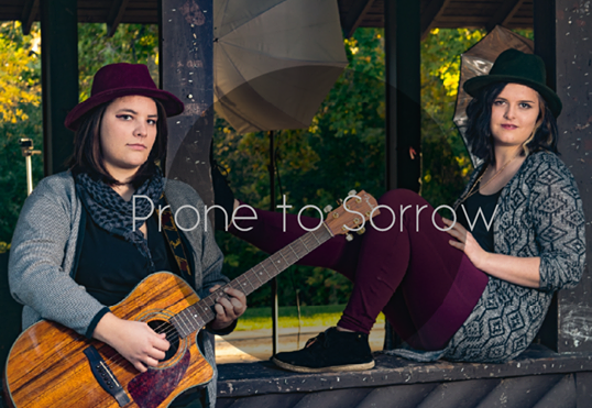 Prone To Sorrow is a duo made up of Mackenzie Benish and Victoria Pearl. This Indie-Acoustic Rock Duo started off as individual songwriters and they came together to share their lyrics and haunting harmonies.