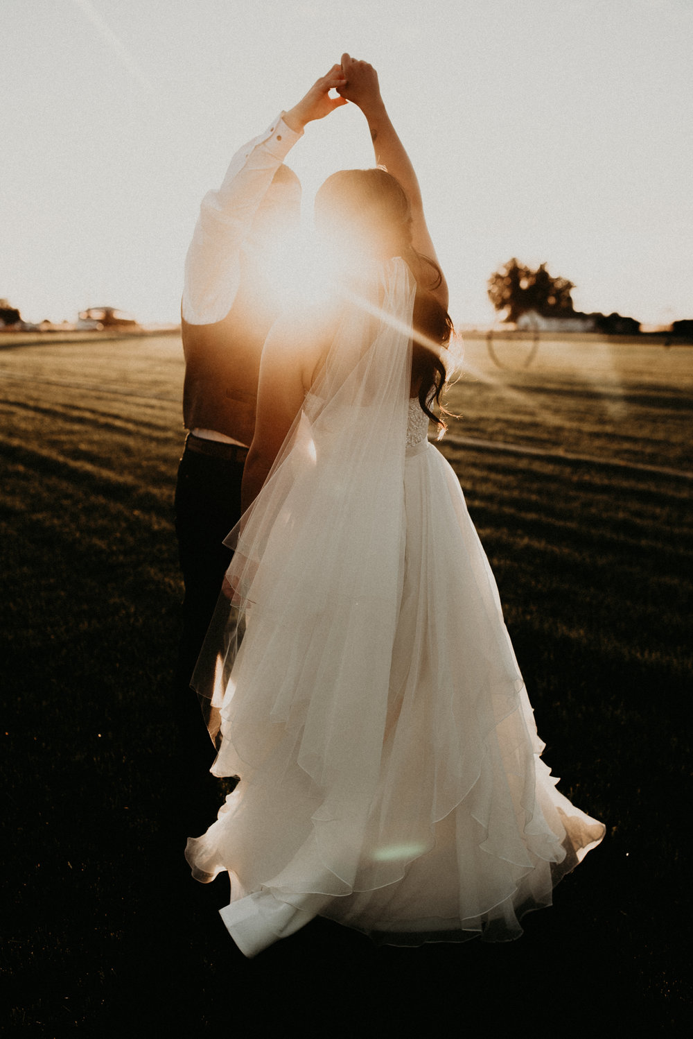 Makayla Madden Photography Dance With Me Boise Wedding Photographer Still Water Hollow Bride Groom White Chapel Wedding Venue Rustic Countryside Wedding Ideas Inspiration Sunflare Golden Hour