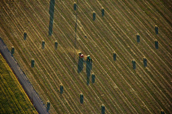 A farmer tends hay bales north of Monmouth.