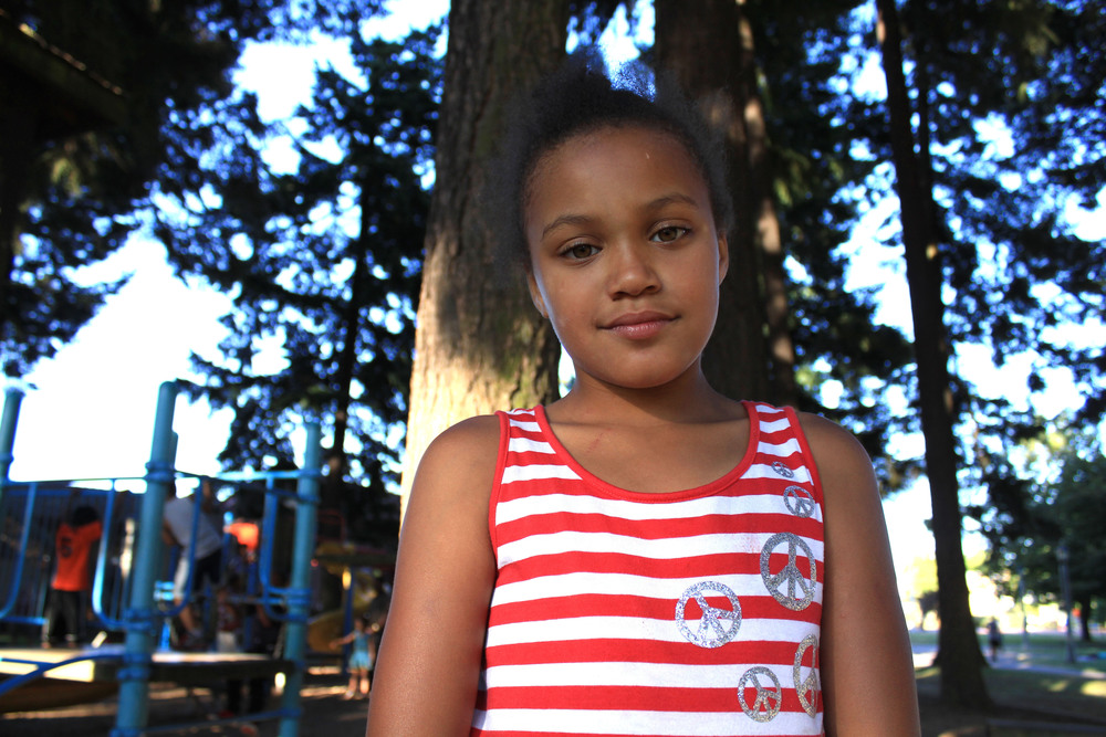 Portrait of a young girl in Peninsula Park, North Portland.  Photo by Helen Silvis